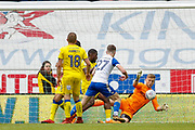 AFC Wimbledon goalkeeper George Long (1), on loan from Sheffield United, saves from Wigan Athletic midfielder Ryan Colclough (27)  during the EFL Sky Bet League 1 match between Wigan Athletic and AFC Wimbledon at the DW Stadium, Wigan, England on 28 April 2018. Picture by Simon Davies.