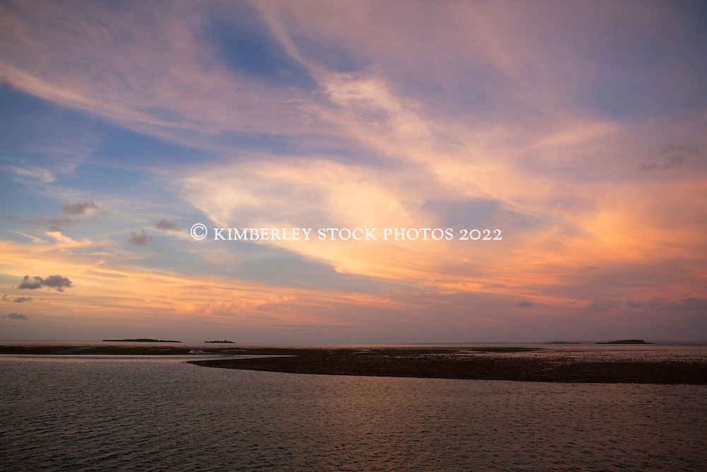 Beautiful wet season sunset over Montgomery Reef in Collier Bay on the Kimberley coast.