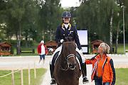 Dana van Lierop - DJ Tiesto<br /> FEI European Championships Dressage Juniors and Young Riders 2012<br /> © DigiShots
