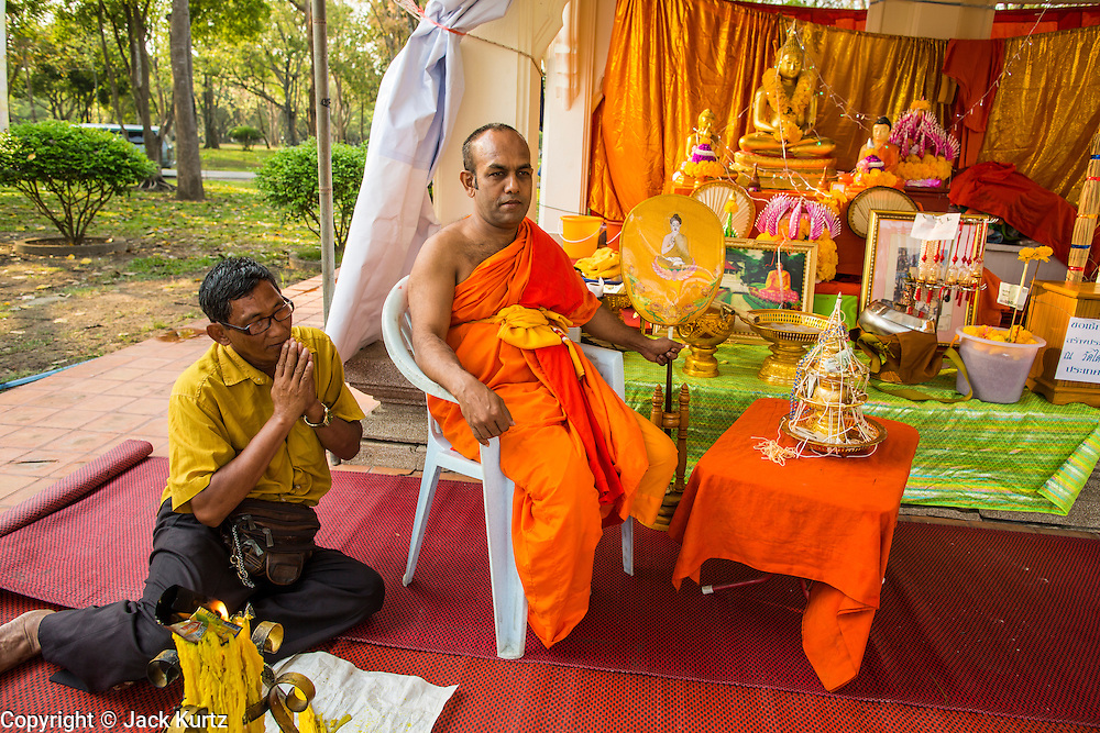 20 FEBRUARY 2013 - PHUTTHAMOTHON, NAKHON PATHOM, THAILAND:     A Sri Lankan Buddhist monk and his assistant in Phutthamonthon Buddhist Park in Phutthamonthon district, Nakhon Pathom Province of Thailand, west of Bangkok. The centerpiece of the park is a 52 foot high Buddha statue, which is said to be the highest free-standing Buddha statue in the world.       PHOTO BY JACK KURTZ