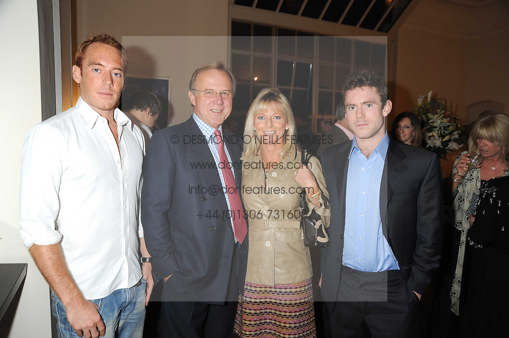 Left to right, the HON.HARRY BRIDGEMAN, PHILIP & JOANNE PORTER and the HON.BEN BRIDGEMAN at the launch party of Ingrid Seward's new book 'William & Harry - The People's Princes' held at 47 Hornton Court West, London W8 on 7th October 2008.