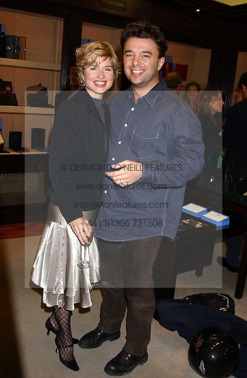 Left to right, ISSY VAN RANDWYCK and her husband MR EDWARD HALL son of Peter Hall at a party to celebrate the launch of The Monneypenny Diaries at Smythson, 40 New Bond Street, London W1 on 4th October 2005.<br /><br />NON EXCLUSIVE - WORLD RIGHTS