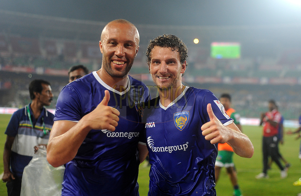 Mikael Silvestre of Chennaiyin FC poses with teammate Elano Blumer of Chennaiyin FC as they celebrate after winning match 15 of the Hero Indian Super League between Chennaiyin FC and Mumbai City FC held at the Jawaharlal Nehru Stadium, Chennai, India on the 28th October 2014.<br /> <br /> Photo by:  Pal Pillai/ ISL/ SPORTZPICS