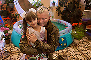 Julia Paevska is hugging a girl attending kindergarten in Myronivs'kyi, a small town near the frontline of eastern Ukraine.