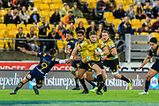Beauden Barrett running with the ball during the super rugby union  game between Hurricanes  and Highlanders, played at Westpac Stadium, Wellington, New Zealand on 24 March 2018.  Hurricanes won 29-12.