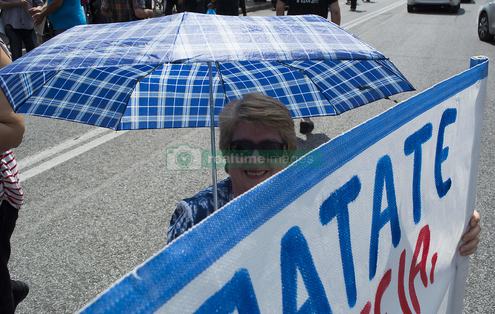 June 9, 2017 - Athens, Greece - Members of PAME, the workers' union affiliated with the Grek Communist Party protest outside the parliament over new austerity measures that are about to be voted for by the government. (Credit Image: © Nikolas Georgiou via ZUMA Wire)