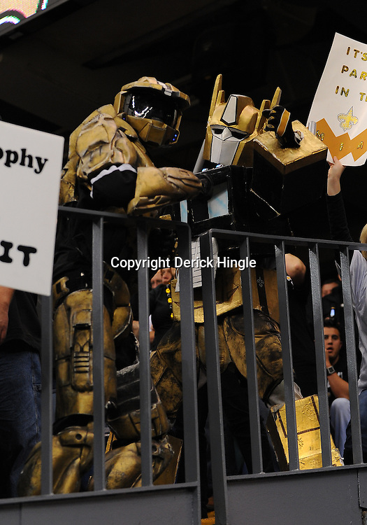 16 January 2010:  New Orleans Saints fans dressed as robots cheer from the stands during a 45-14 win by the New Orleans Saints over the Arizona Cardinals in the 2010 NFC Divisional Playoff game at the Louisiana Superdome in New Orleans, Louisiana.