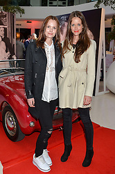 Left to right, CHARLOTTE DE CARLE and her sister NICHOLE DE CARLE at a private view of Marilyn - The Legacy of a Legend held at the Design Centre, Chelsea Harbour, London on 25th May 2016.