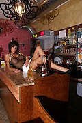 Sexpresso: Wives ban their husbands from visiting Italian cafe where busty barmaid serves up drinks in skimpy outfits <br /> <br /> A sexy barmaid has infuriated wives and girlfriends of a small Italian town after she began serving cappuccinos and beers in skimpy revealing outfits.<br /> Laura Maggi, 34, who runs a bar called Le Cafe, has dominated newspapers and TV chat shows, after pictures of her dressed in barely anything appeared on the internet and a Facebook page dedicated to her has also been set up, with more than 5,000 friends.<br /> Since she began appearing behind the bar frothing up cappuccino and serving drinks dressed in skimpy black outfits and tinsel trimmed bras, punters have flocking to her bar - so much so that the mayor is now considering an emergency bylaw to cope with the huge amount of traffic and double parked cars.<br /> <br /> However the women folk of Bagnolo Mella, near Brescia, which is where Manchester City ace Mario Balotelli is from, are up in arms and several of them appeared on TV chat shows today describing how they had banned their partners from going to Le Cafe.<br /> <br /> One said:'It is outrageous and should not be allowed. This town is quiet and respectable now we are known across the whole country because of the little amount of clothing this barmaid is wearing to serve drinks. The women in town are not very happy and we have complained to the council.'<br /> Bagnolo's mayor Cristina Almici has also banned her husband from going to Laura's bar and said:'We have received several complaints from women in the town about the bar and we are looking at what we can do with regard to public order.<br /> 'There has been a huge influx of traffic into the town since the news of Laura started to spread and this has led to incidents if bad parking and some minor acts of vandalism but in essence there is not much we can do she has a licence and can stay open.<br /> 'We can't stop people from going to her bar and I know it is very popula