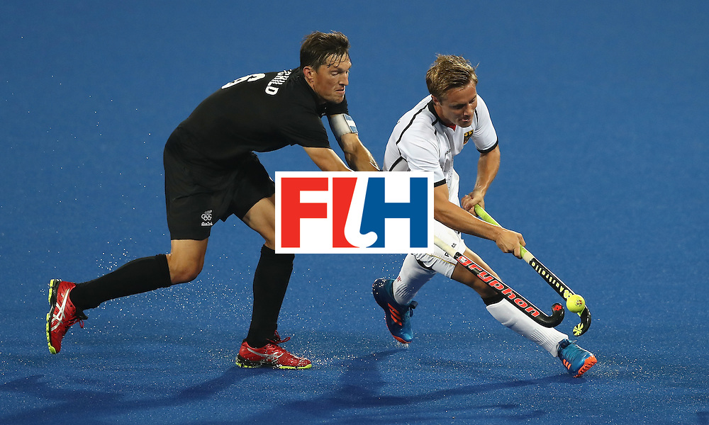 RIO DE JANEIRO, BRAZIL - AUGUST 14:  Matts Grambusch(R) of Germany is tackled by Simon Child during the Men's hockey quarter final match between the Germany and New Zealand on Day 9 of the Rio 2016 Olympic Games at the Olympic Hockey Centre on August 14, 2016 in Rio de Janeiro, Brazil.  (Photo by David Rogers/Getty Images)