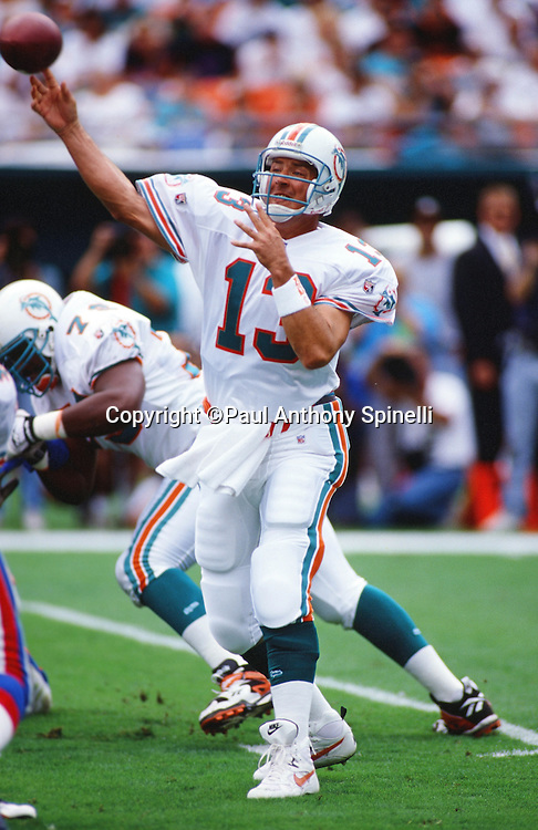 Miami Dolphins quarterback Dan Marino (13) throws a pass during the NFL football game against the New England Patriots on Nov. 12, 1995 in Miami Gardens, Fla. The Patriots won the game 34-17. (©Paul Anthony Spinelli)