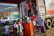 2016/10/09 – Jama, Ecuador: People doing some shopping in a truck of Tia Supermarkets, Jama, Ecuador, 9th October 2016. The town's supermarket of the commercial chain was completely destroyed so they operate from trucks until new installations are built. (Eduardo Leal)