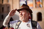 "09 JANUARY 2012 - PHOENIX, AZ:  ""Buffalo"" Rick Galeener (CQ) salutes during the Pledge of Allegiance at the state legislature Monday. Gov Brewer delivered her State of the State inside while outside representatives of interest groups picketed and protested.    The Arizona legislature started its 2012 session and Gov. Jan Brewer delivered her State of the State Monday, Jan 9.                   PHOTO BY JACK KURTZ"