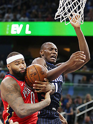 December 22, 2017 - Orlando, FL, USA - The New Orleans Pelicans' DeMarcus Cousins, left, takes the ball from the Orlando Magic's Bismack Biyombo (11) at the Amway Center in Orlando, Fla., on Friday, Dec. 22, 2017. (Credit Image: © Stephen M. Dowell/TNS via ZUMA Wire)