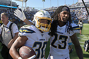 Sep 8, 2019; Carson, CA, USA; Los Angeles Chargers running back Austin Ekeler (30) celebrates with defensive back Rayshawn Jenkins (23) after scoring on a 7-yard touchdown run in overtime against the Indianapolis Colts at Dignity Health Sports Park. The Chargers defeated the Colts 30-24 in overtime.