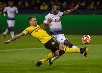 Football - 2018 / 2019 UEFA Champions League - Round of Sixteen, Second Leg: Borussia Dortmund (0) vs. Tottenham Hotspur (3)<br /> <br /> The outstretched boots of Davinson Sanchez (Tottenham FC)  and Paco Alcacer (Borussia Dortmund) battle for the ball at Signal Iduna Park (Westfalenstadion).<br /> <br /> COLORSPORT/DANIEL BEARHAM