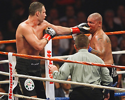 Sept 26, 2009; Los Angeles, CA, USA; Vitali Klitschko and Cris Arreola trade punches during their 12 round bout at the Staples Center.  ..Klitschko won the fight via TKO in the 11th round when Arreola's trainer, Henry Ramirez stopped the fight...Mandatory Credit: Craig Bennett/FightWireImages.com