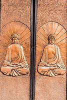 doors with buddha carving at Soho Central in Hong Kong