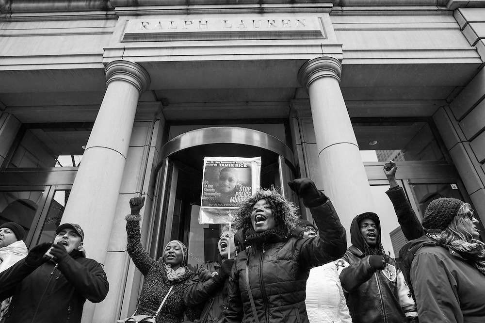 Protesters block Black Friday shoppers from entering the Ralph Lauren store on Michigan Avenue in response to police officer Jason Van Dyke killing 17-year-old Laquan McDonald.