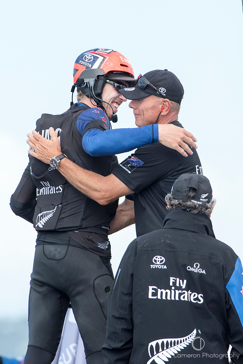 The Great Sound, Bermuda 12th June 2017. Emirates Team New Zealand helmsman Peter Burling gets a hug from CEO Grant Dalton after winning the Louis Vuitton America's Cup Challenger series.