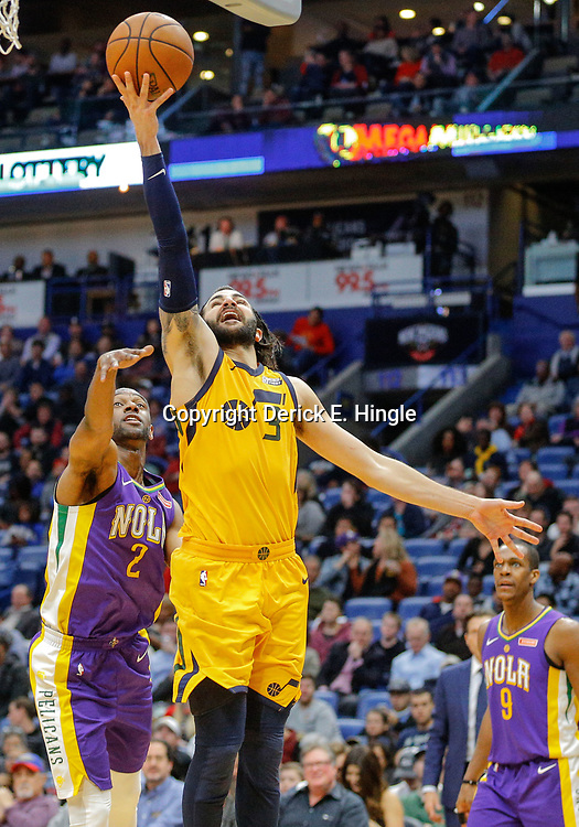 Feb 5, 2018; New Orleans, LA, USA; Utah Jazz guard Ricky Rubio (3) shoots past New Orleans Pelicans guard Ian Clark (2) during the second half at the Smoothie King Center. The Jazz defeated the Pelicans 133-109. Mandatory Credit: Derick E. Hingle-USA TODAY Sports