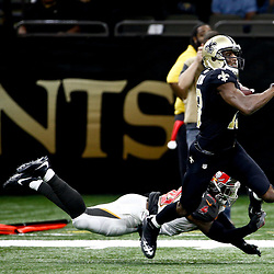 Dec 24, 2016; New Orleans, LA, USA; New Orleans Saints wide receiver Michael Thomas (13) is tripped up by Tampa Bay Buccaneers free safety Bradley McDougald (30) during the second half of a game at the Mercedes-Benz Superdome. The Saints defeated the Buccaneers 31-24. Mandatory Credit: Derick E. Hingle-USA TODAY Sports