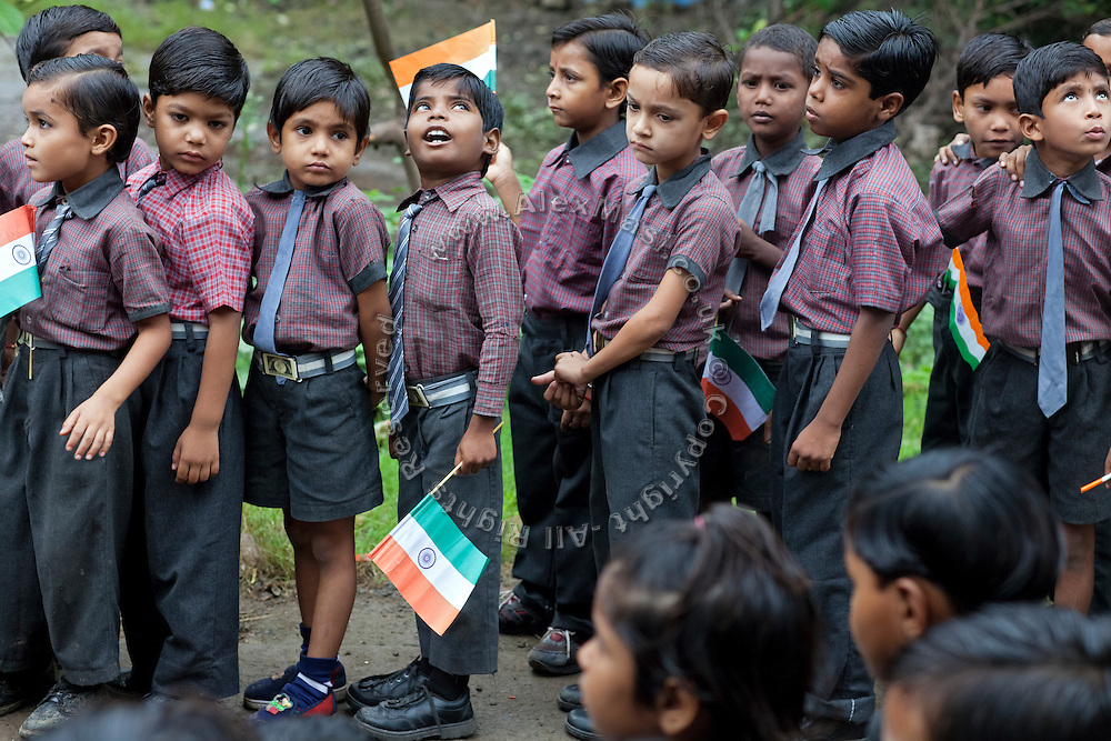 Pupils are attending celebrations for India's Independence Day 2012 in front of their school in one of the water-affected colonies near the abandoned Union Carbide (now DOW Chemical) industrial complex in Bhopal, Madhya Pradesh, central India.