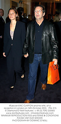 Musician ERIC CLAPTON and his wife, at a reception in London on 14th October 2003.PNL 215