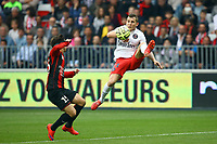 Lucas Digne of Paris SG jumps to control the ball under pressure from Gregoire Puel of OGC Nice during the French championship L1 football match between Nice and Paris Saint Germain on April 18, 2015 at the Allianz Riviera stadium in Nice, France. <br /> Photo: Manuel Blondeau / AOP Press/ DPPI