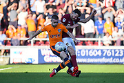 Oldham Athletic midfielder Jack Byrne (29) battles for possession  with Northampton Town defender Brendan Maloney (2) during the EFL Sky Bet League 1 match between Northampton Town and Oldham Athletic at Sixfields Stadium, Northampton, England on 5 May 2018. Picture by Dennis Goodwin.