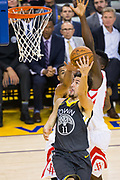 Golden State Warriors guard Klay Thompson (11) handles the ball against the Houston Rockets during Game 4 of the Western Conference Finals at Oracle Arena in Oakland, Calif., on May 22, 2018. (Stan Olszewski/Special to S.F. Examiner)