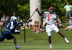 Virginia Cavaliers M Rhamel Bratton (3) leaps for a loose ball against Villanova.  The #5 ranked Virginia Cavaliers defeated the #19 ranked Villanova Wildcats 18-6 in the first round of the 2008 NCAA Men's Lacrosse Tournament the University of Virginia's Klockner Stadium in Charlottesville, VA on May 10, 2009.