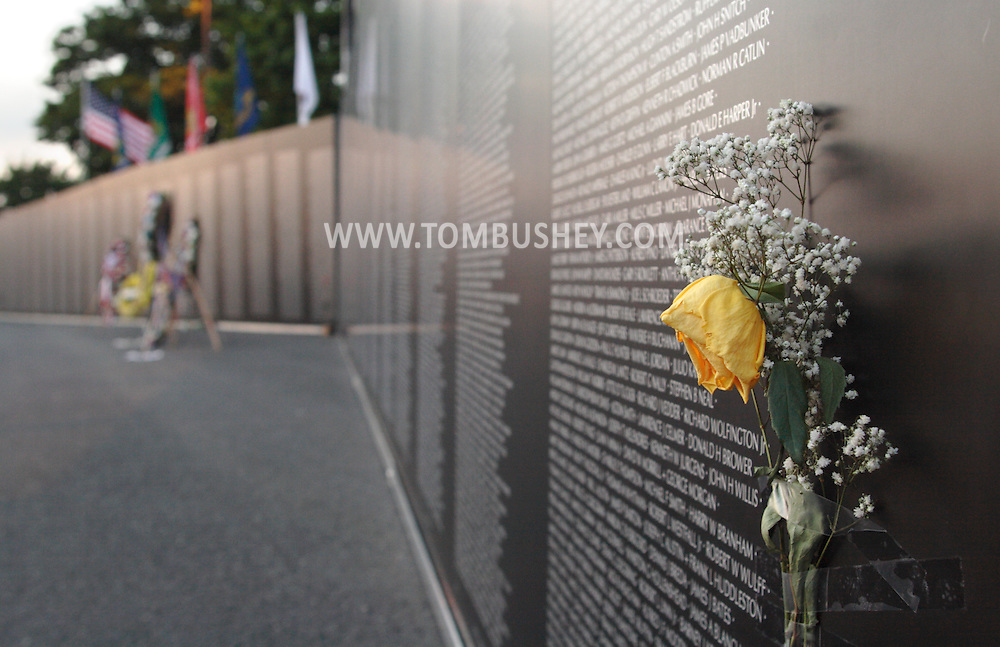 Newburgh, NY - A yellow rose is taped to the Vietnam Veterans Memorial Moving wall at Stewart International Airport on June 6, 2009.