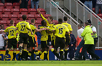 Photo. Glyn Thomas.<br /> Middlesbrough v Aston Villa. <br /> FA Barclaycard Premiership. 24/04/2004.<br /> Aston Villa's Peter Crouch (arms raised) is mobbed by teammates after scoring his side's winning goal as Villa fans (R) are arrested.