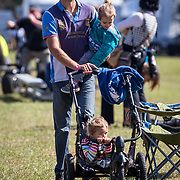Xavier Traisnel, husband of rider, Lindsay Traisnel (CAN) out with their children at the Red Hills International Horse Trials in Tallahassee, Florida.