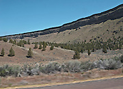 scene along a cross country trip with in a classic Mini Cooper auto - Deschutes River Canyon walls are seen from US 26