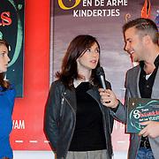 NLD/Amsterdam/20121113 - Presentatie DE Sinterklaasboekjes 2012,  Annette Marnat, Carice van Houten en Winston Gerstanowitz