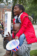 A man and his daughter in Parliament Square, London, awaiting the arrival of guests and members of the British royal family prior to the wedding of Prince William to Catherine Middleton. The wedding was held at Westminster Abbey. Tens of thousands of people lined the streets to wish the couple well before and after the ceremony.