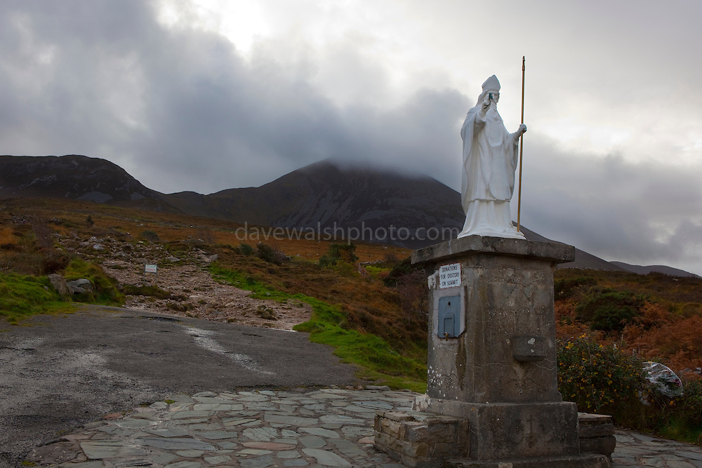 "Statue of St. Patrick on the Pilgrim's Path up Croagh Patrick Mountain, Mayo, in the West of Ireland. An important site of pilgrimage, on Reek Sunday"", the last Sunday in July every year, over 15,000 pilgrims climb it. Croagh Patrick is 764 metres (2,507 ft) high."