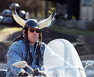 An unidentified motorcyclist wears a horn helmet while riding Sunday February 28, 2016 in New Hope, Pennsylvania. It was unseasonably warm Sunday in Bucks County and people flocked in droves to New Hope. (Photo by William Thomas Cain)