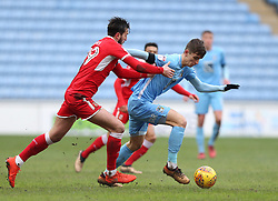 Coventry City's Tom Bayliss and Swindon Town's Oliver Banks battle for the ball