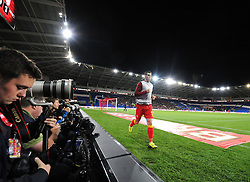 Gareth Bale of Wales (Real Madrid) warms up in front of the gathering photographers  - Photo mandatory by-line: Joe Meredith/JMP - Tel: Mobile: 07966 386802 10/09/2013 - SPORT - FOOTBALL - Cardiff City Stadium - Cardiff -  Wales V Serbia- World Cup Qualifier