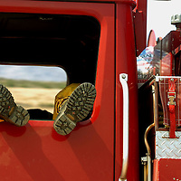A Firefighter rests in his truck in Lucerne Valley during the Butler II, Sunday, Sept. 16, 2007.