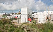 Calais, Pas-de-Calais, France - 17.10.2016    <br />  <br /> Refugees who leave their fingerprints and were registrated live in a container village - but many don&acute;t want to apply for asylum in France and head on to Britain. &rdquo;Jungle&quot; refugee camp on the outskirts of the French city of Calais. Many thousands of migrants and refugees are waiting in some cases for years in the port city in the hope of being able to cross the English Channel to Britain. French authorities announced that they will shortly evict the camp where currently up to up to 10,000 people live.<br /> <br /> Fluechtlinge die ihre Fingerabdruecke abgegeben haben und registriert wurden wohnen in einem Containerdorf - viele wollen jedoch weiter nach Gro&szlig;britanien und nicht in Frankreich Asyl beantragen. &rdquo;Jungle&rdquo; Fluechtlingscamp am Rande der franzoesischen Stadt Calais. Viele tausend Migranten und Fluechtlinge harren teilweise seit Jahren in der Hafenstadt aus in der Hoffnung den Aermelkanal nach Gro&szlig;britannien ueberqueren zu koennen. Die franzoesischen Behoerden kuendigten an, dass sie das Camp, indem derzeit bis zu bis zu 10.000 Menschen leben K&uuml;rze raeumen werden. <br /> <br /> Photo: Bjoern Kietzmann