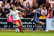Viola Calligaris (#18) of Switzerland takes on Rachel Corsie (#4) of Scotland during the 2019 FIFA Women's World Cup UEFA Qualifier match between Scotland Women and Switzerland at the Simple Digital Arena, St Mirren, Scotland on 30 August 2018.