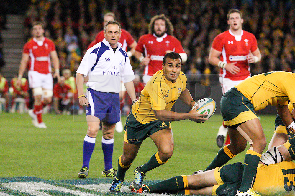 © Licensed to London News Pictures. 16/06/2012. Etihad Stadium, Melbourne Australia. Will Genia passes about to pass the ball during the 2nd Rugby Test between Australia Wallabies Vs Wales . Photo credit : Asanka Brendon Ratnayake/LNP