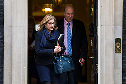 © Licensed to London News Pictures. 20/02/2018. London, UK. Secretary of State for International Development Penny Mordaunt (L) and Transport Secretary Chris Grayling (R) leave 10 Downing Street after the weekly Cabinet meeting. Photo credit: Rob Pinney/LNP