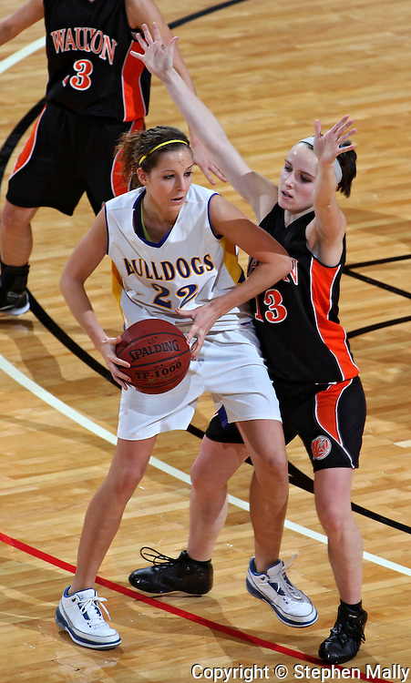 MFL-MarMac's Chelsey Lamker (22) is defended by Waukon's Tatum meyer (13) during their Rivalry Saturday game at the US Cellular Center in Cedar Rapids on Saturday January 2, 2010. Waukon defeated MFL MarMac 48-38 for Coach Gene Klinge's 939th career victory. (Stephen Mally/Freelance)