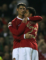 Photo: Paul Thomas.<br /> Manchester United v FC Copenhagen. UEFA Champions League, Group F. 17/10/2006.<br /> <br /> Cristiano Ronaldo (L) of Man Utd hugs Kieran Richardson (23) after he scores their third goal.