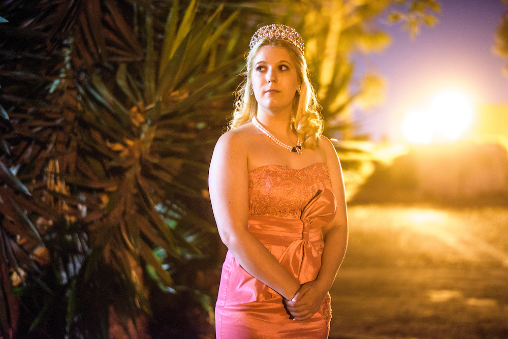 "Anaheim , California - April 11, 2015: Princess Samantha Miller, 18, of The Kingdom of Shiloh stands for a portrait during the MicroCon 2015 Cotillion at the Unitarian Universalist Church in Anaheim Saturday April 11, 2015. While Princess Samantha and her father King Timothy live in Anaheim, Shiloh, their micronation is, as her father King Timothy says ""landlocked by Scotland,"" and less than a mile in size. Although, a few months ago 40 acres of land close to the Grand Canyon were gifted to Shiloh with the contingency that a town be built there. Shiloh also has a national Sports Team, the Lamia Knights, a full armored combat medieval sports team. CREDIT: Matt Roth"